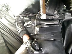 Hot black rubber boy smokes big cigar and strokes