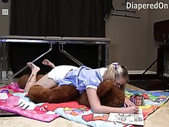 Iris humps her teddy while loading her diapers