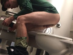 Guy in green on toilet