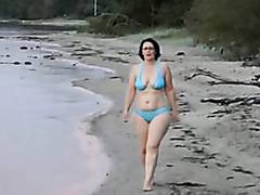 Chubby girl walks by the lake naked