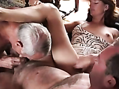 Sucking a dick while the wife watches