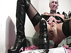 Kinky mature slut takes a massive dildo in the ass