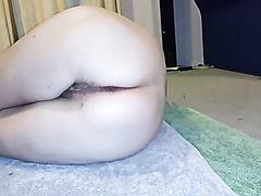 Kinky slut laying on the floor pissing