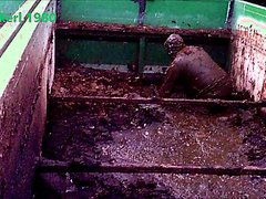 worker playing in slurry container