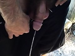 Guy with awesome pubes taking a piss