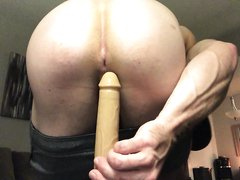 straight hunk taking a dildo