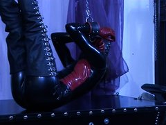 German Babe In Black Latex Puts Herself Into Self Bondage