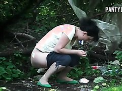 Russian mom poops outdoors