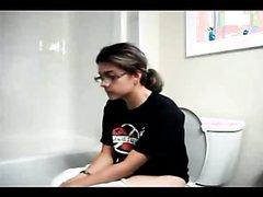 lady pooping in bathroom video 1