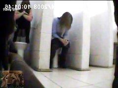 Girls using doorless toilets