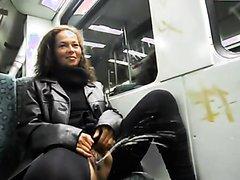 Crazy brunette piss in the train