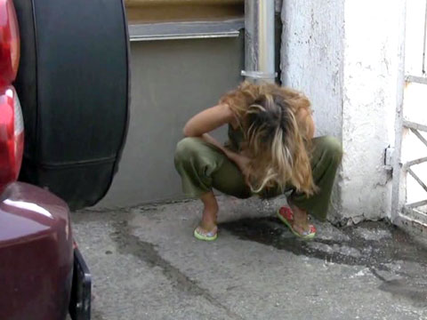 Russian whore goes pee in public