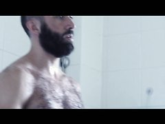 Shower time of muscle hairy man