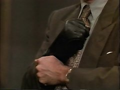 Mobster pulls on a glove to give a beating
