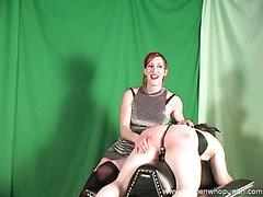 Domina spanking the slave