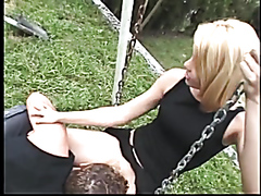 Babe shoves a big strap-on in a dude's ass