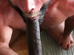 Muscular daddy sucking huge black cock