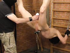 slave hung by feet and balls part 4- whip cane clamps wax