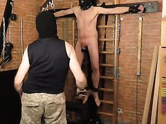 slave hung by feet and balls part 5- whip cane clamps wax