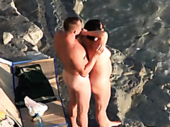 Couple acts naughty at the beach