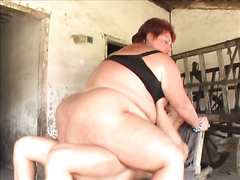 Mature fatty fucked by a young stud