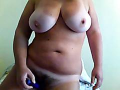 Busty fat blonde anally masturbating