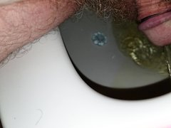 Small dick taking a morning piss