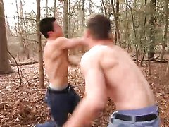 Shirtless fistfight in woods