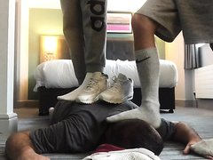 Two masters dominate older slave with stinky socks