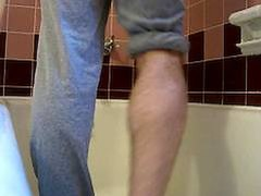 Guy pissing on himself - video 2