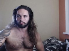 Long-haired cam guy performing.