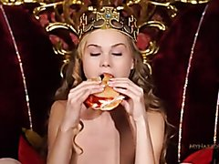 Blonde eats a burger nude and fingers