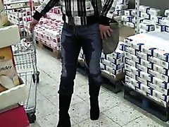 girl pisses pants whilst shopping