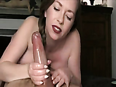 Stunning milf tugging a huge dick