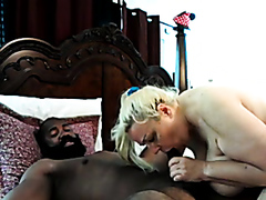 Thick white chick riding a black cock