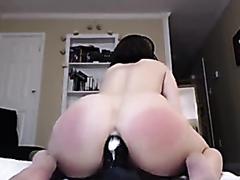 Super hot brunette riding a massive dildo