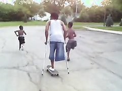 Amputee guy with crutches on skateboard