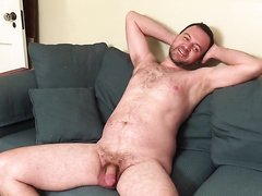 Man posing nude on the couch