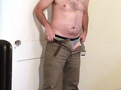 Undressing man in his home