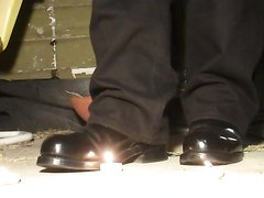 COP BOOTS GRIND LIT CANDLES INTO GROUND