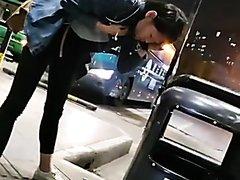 Chinese girl vomiting at bus terminus