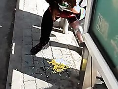 Chinese girl vomiting at bus stop