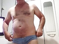 Mature man naked in the work place