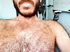 hairy guy drools & spits