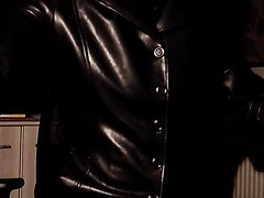 Breathplay masturbating pierced cock in black leather coat