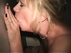 Blonde slut sucking dick through a hole