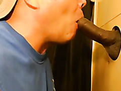 White guy sucking a big black cock