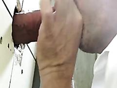 Mature dude sucks dick through a hole