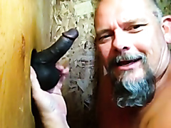 Old white guy sucking on a black cock
