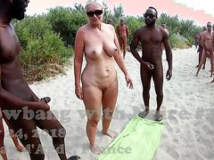 NUDIST SLUT GANGBANG ON THE BEACH